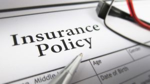 loss assessor and loss adjuster: what's the difference, Image of an insurance policy for a post indicating who is likely to help you in an insurance claim