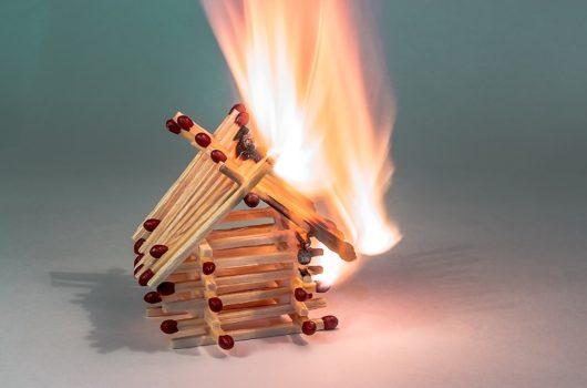 House made of matchsticks on fire